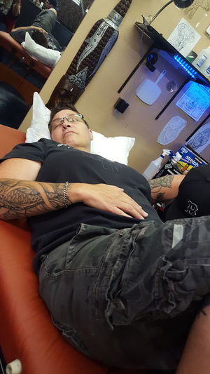 Tattoo Tatted Inked Real People Scene Laying Down Tattoo Parlour Inside Tattoo Life Enjoy The New Normal Uniqueness Women Around The World Business Stories Love Yourself