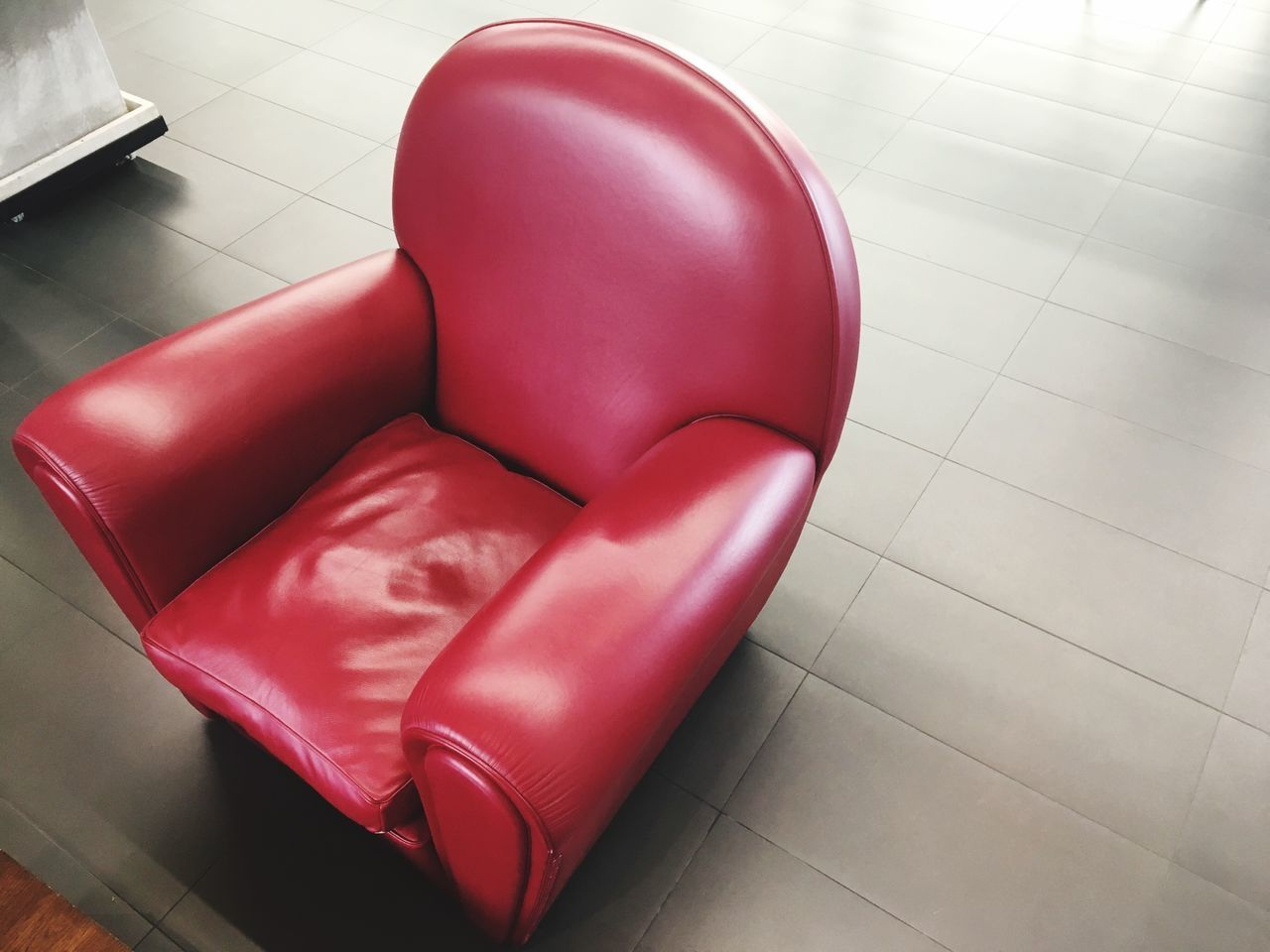 tiled floor, indoors, high angle view, no people, chair, home interior, seat, red, close-up, day, toilet bowl