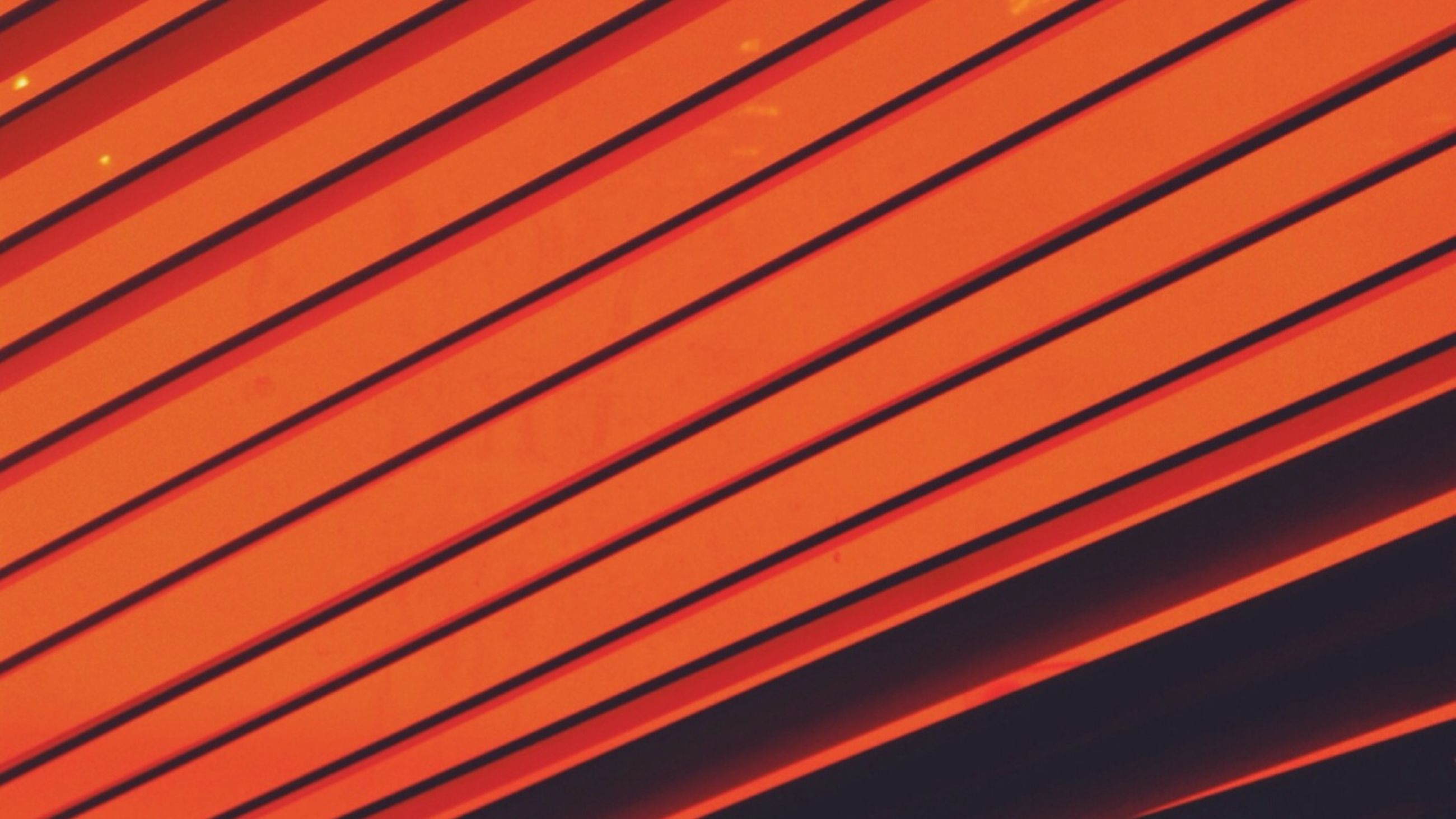 full frame, backgrounds, pattern, orange color, indoors, close-up, repetition, built structure, blinds, textured, abstract, architecture, design, low angle view, detail, metal, no people, red, yellow, window