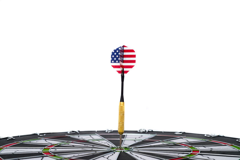 Center target of darts isolated on a black background Dartboard Bulls-eye Win Successful Center Public Metaphor Point Result Dart Targeting Victory Black Sport Board Mark Perfection Strategy Relations Conceptual Target Marketing Challenge Media Isolated American Circles Red Hit White Accuracy Objects Luck Accurate Perfect Arrow Patterns Ideas Game Flag Concept Direct Bull Success Eye Market Winner Background Play Copy Space White Background No People Studio Shot Striped Patriotism Cut Out Indoors  Close-up Still Life Shape Sky Nature Arts Culture And Entertainment Clear Sky National Icon
