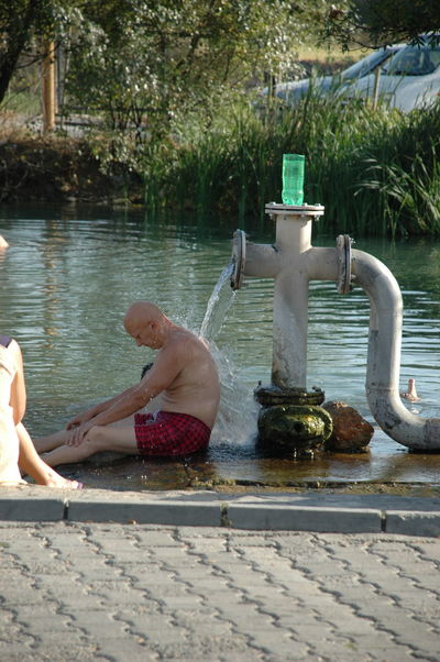 Adult Adults Only Day Drinking Water Fountain Leisure Activity Lifestyles Men Nature Outdoors People Refreshment Taking A Bath Two People Water