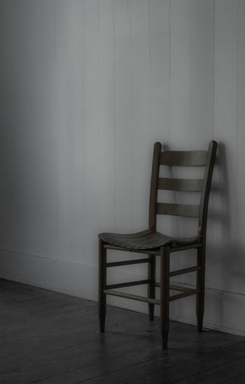 Empty chairs against wall at home
