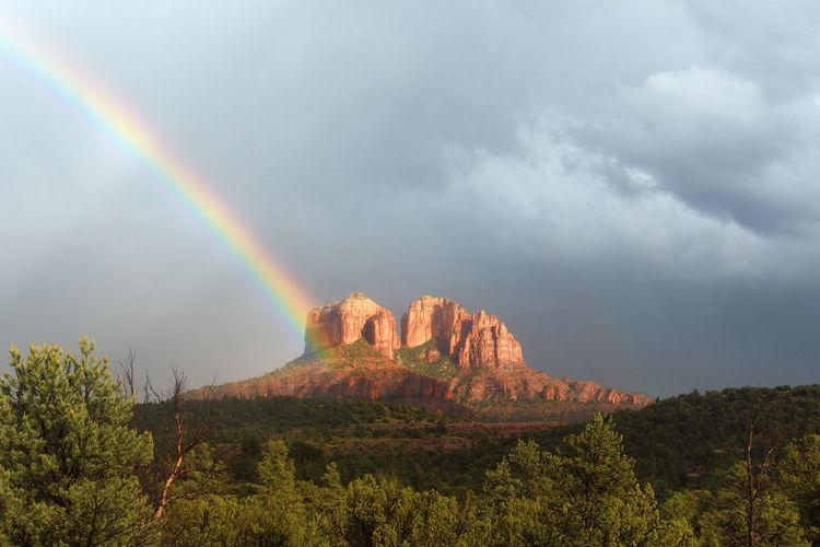 Rainbow Over Mountain Against Sky