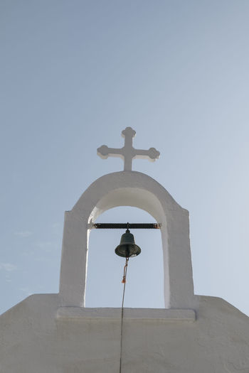Low angle view of cross against clear sky