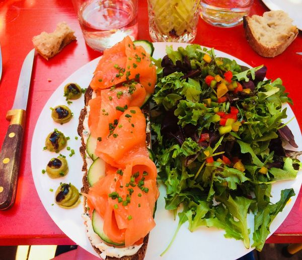 Summer lunch Red White Green Glass Knife Bread Light Lunch Plate Olive Salmon Outdoor Food And Drink Food Healthy Eating Ready-to-eat Freshness Wellbeing Plate Vegetable Meal Still Life High Angle View No People Tomato Table Salad Close-up