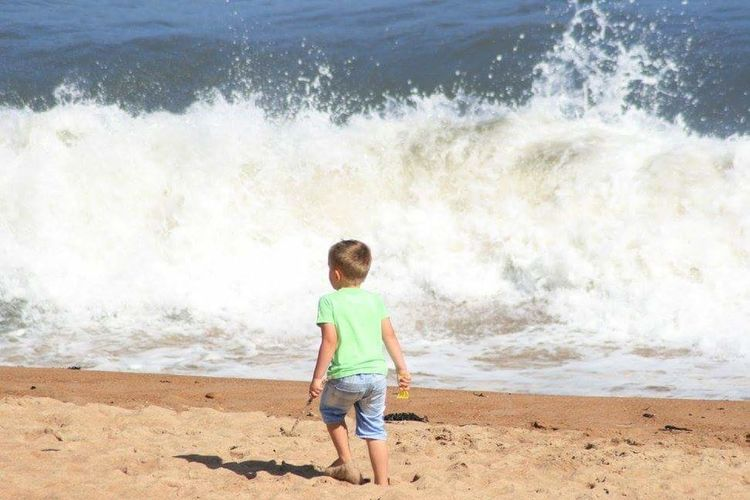 Water Children Only Wave Beach Travel Destinations Sand Motion Sea One Person Full Length Childhood Power In Nature Outdoors Nature People Day