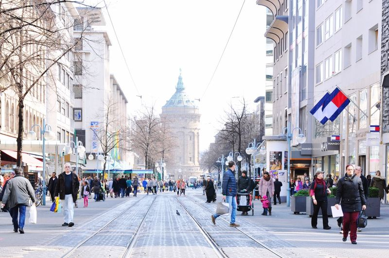 Citycape, N7, Mannheim 🏢🏠✨ Architecture City Large Group Of People Crowd Built Structure Group Of People My Best Photo Building Exterior Transportation Real People Street Road Women Walking Lifestyles City Life The Way Forward City Street Nature Sky Adult