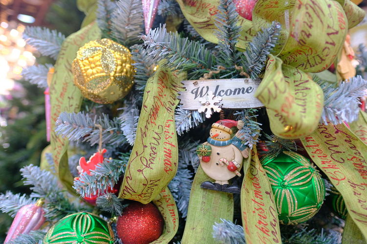 Close-up of decorations hanging at market stall