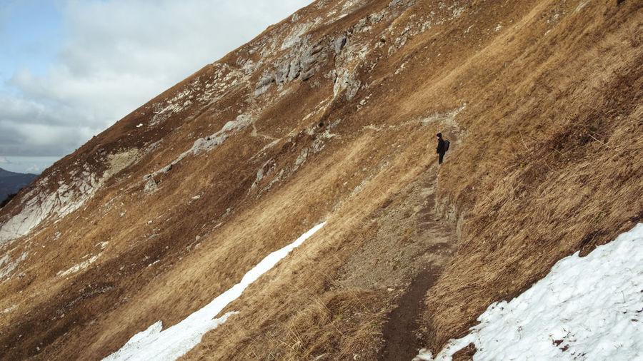 Woman standing on mountain ridge