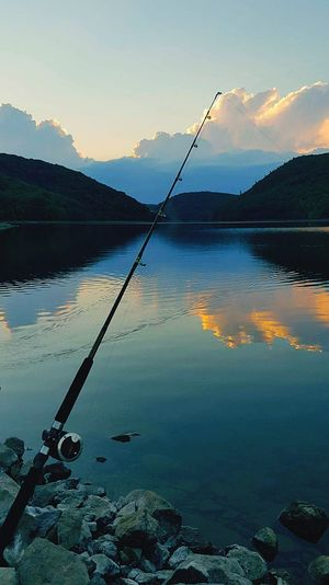"""Time to Fish"" This was taken somewhere in Northern CT. I think the Winsted area. So peaceful. definitely a place for ""me time."" EyeEm Me Time ♥ Warm Weather Relaxation Vacation Hills Ripples In The Water Clear Water Pristine Clouds And Sky Quiet Moments Tranquility The Great Outdoors - 2018 EyeEm Awards Water Lake Fishing Reflection Fishing Tackle Sunset Sky Fishing Equipment Fishing Rod Countryside"