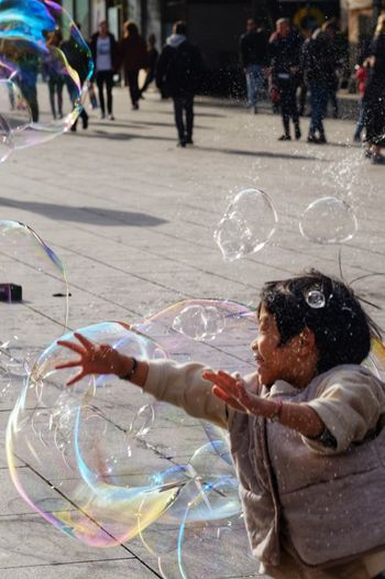 Kids Candid Candid Photography Streetphotography Street Photography Playing Happiness Joy Bubble Wand Spraying Men City Bubble