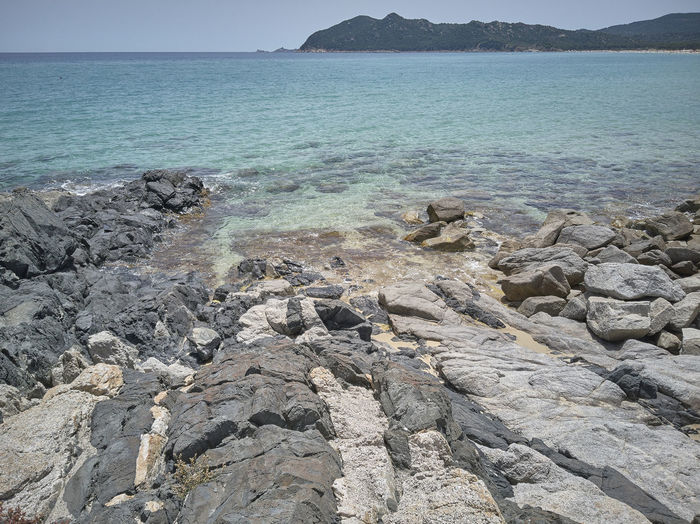 Beach Beauty In Nature Day Idyllic Land Mountain Nature No People Non-urban Scene Outdoors Rock Rock - Object Rocky Coastline Scenics - Nature Sea Sky Solid Tranquil Scene Tranquility Water