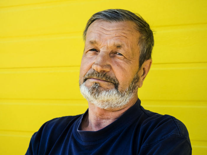 Adult Beard Casual Clothing Close-up Eldery Eldery Man Facial Hair Front View Headshot Human Face Lifestyles Looking At Camera Males  Mature Adult Mature Men Men Mustache One Person Portrait Real People Senior Adult Smiling Yellow