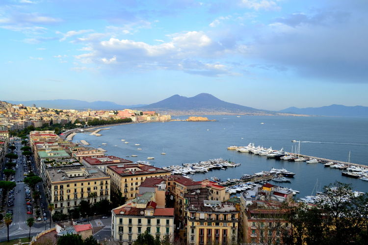 Naples Architecture Beauty In Nature Building Exterior Built Structure City Cityscape Day Harbor High Angle View Moored Mountain Mountain Range Nature Nautical Vessel No People Outdoors Residential Building Scenics Sea Sky Town Transportation Vesuvius  Water