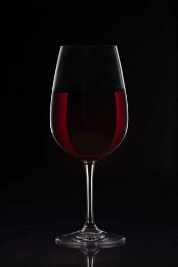 Red wine glass with wine on black background Black Background Celebration Copy Space Isolated Red Wine Alcohol Backgrounds Black Black Background Close-up Drink Drinking Glass Food And Drink Indoors  No People Red Wine Studio Shot Wine Wine Cask Wineglass Winetasting