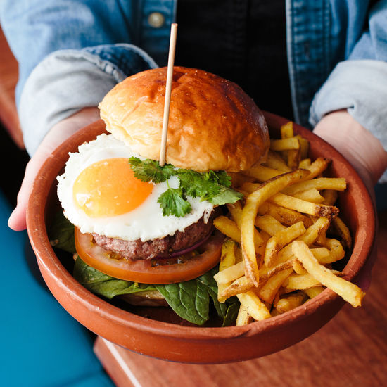not healthy eating Egg Yolk Fried Egg Burger Close-up Day Egg Food Food And Drink French Fries Freshness Hamburger Human Hand Indoors  Meat Midsection One Person People Plate Ready-to-eat Real People Serving Size Table Unhealthy Eating