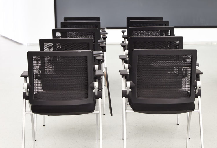 Close-Up Of Empty Chairs In Classroom