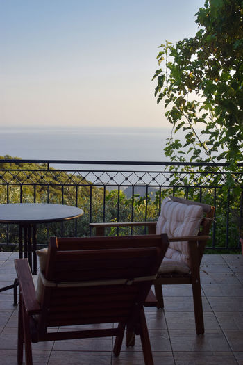 Sea view on a sunny afternoon Holiday Mediterranean  Relaxing Tranquility View Absence Beauty In Nature Chair Greece Horizon Horizon Over Water Nature No People Outdoors Plant Railing Scenics - Nature Sea Seat Sky Table Tranquility Travel Destinations Tree Water