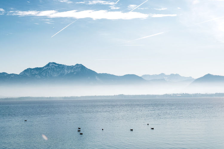 Water Beauty In Nature Mountain Scenics - Nature Waterfront Nature Sky Tranquil Scene Mountain Range Tranquility No People Outdoors Chiemsee Sea Fog Sky And Clouds Calm