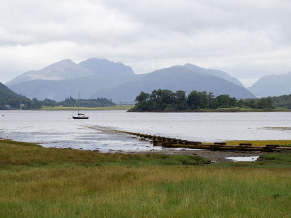 View Over Loch Leven in Glencoe, Scotland Glencoe Highland Loch Leven Scotland Beauty In Nature Boat Day Highlands Of Scotland Mountain Mountain Range Nature Nautical Vessel No People Outdoors Scenics Sky Water