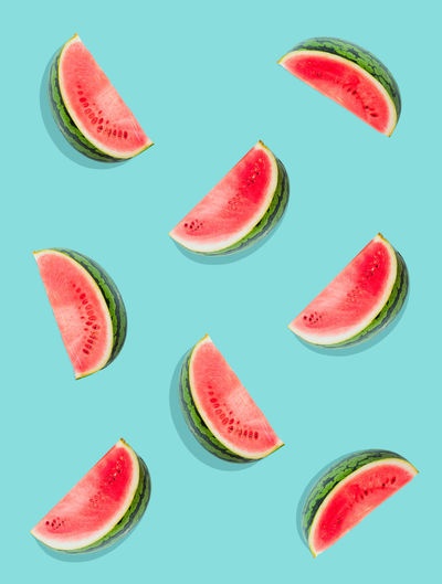 Watermelon pattern. Slices of watermelon on a plain surface painted in bright blue Food Fruit Ripe No People SLICE Watermelon Freshness Wellbeing Healthy Eating Diet Clean Freshness Fresh Fruity Sweet Summer Organic Natural Ingredient Green Melon Lay Flat Vegetarian