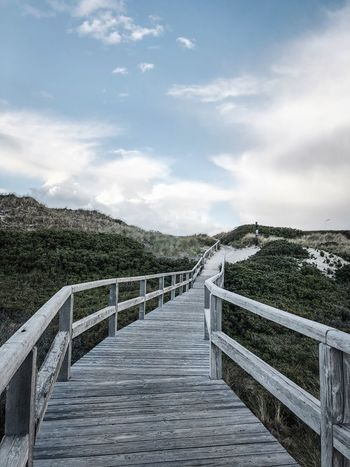 Sky Cloud - Sky Nature Day Plant Railing Direction No People Tree The Way Forward Architecture Tranquil Scene Tranquility Boundary Security Fence Outdoors Built Structure Barrier Safety