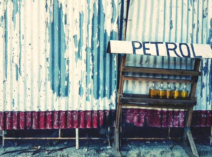 Petrol In Bottles Against Corrugated Iron