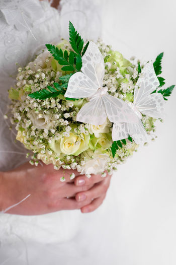 Beautiful bridal bouquet decorated with butterflies Beautiful Beauty Bouquet Bridal Bouquet Bride Bunch Of Flowers Butterfly Close Up Close-up Flower Flowers Freshness Holding Human Body Part Human Hand Leaf One Person Roses Summer Wedding Wedding Dress Weding White Color Women