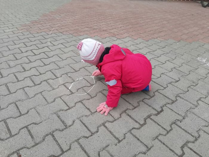 High angle view of child on footpath