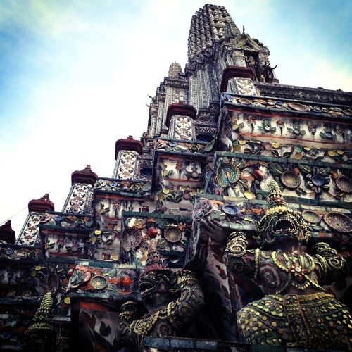 Low angle view of sculptures on temple against sky