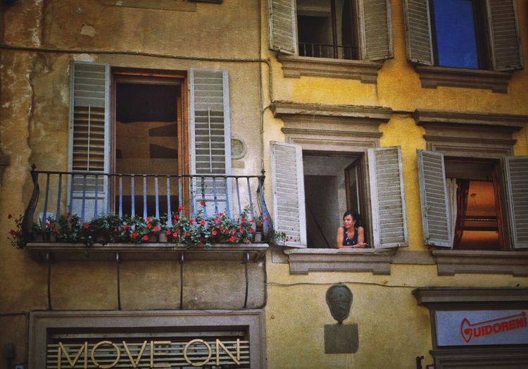 Streetphotography Street Photography Window Womaninthewindow Florence Architecture Built Structure Building Exterior Balcony Low Angle View Residential Building Day History Historic Person Architectural Feature