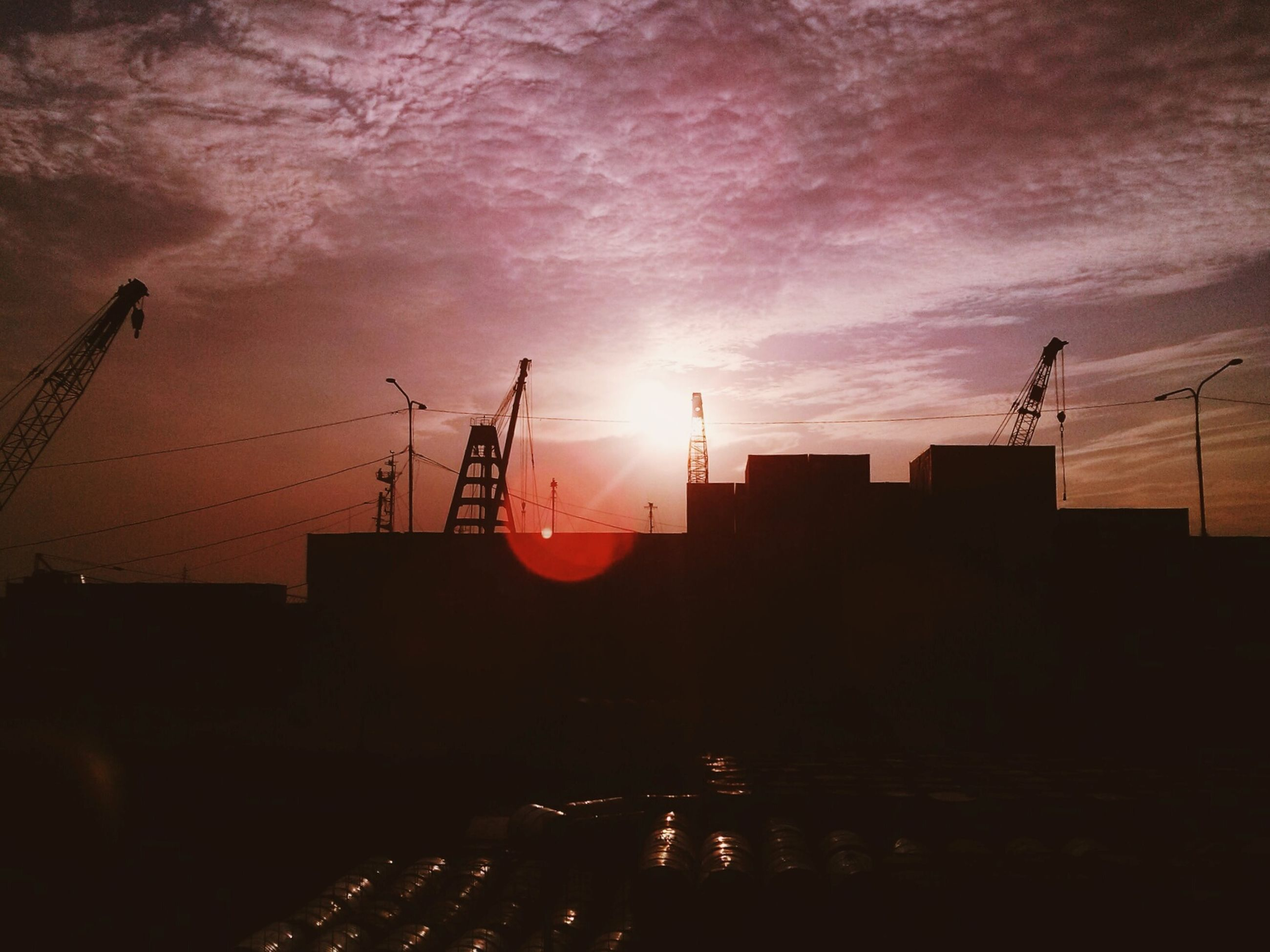building exterior, sunset, architecture, built structure, sky, silhouette, crane - construction machinery, construction site, cloud - sky, development, city, crane, industry, orange color, building, dusk, cloudy, cloud, outdoors, construction