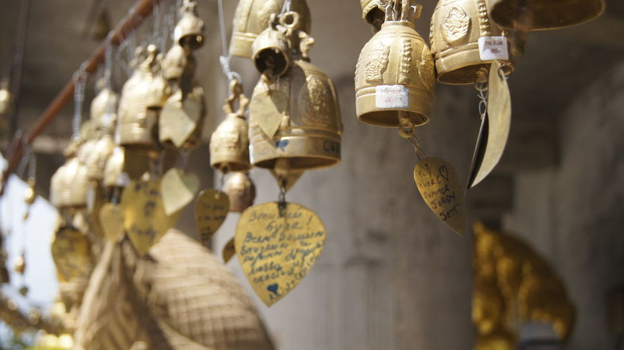 Close-Up Of Bells Hanging At Temple