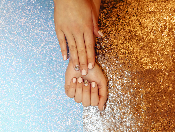 Cropped hands of woman with glitter