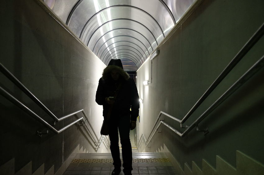 Dark Entrance Underpass Concept Dangerous Men One Person Railing Real People Staircase Standing Steps Steps And Staircases Subway Station Walking