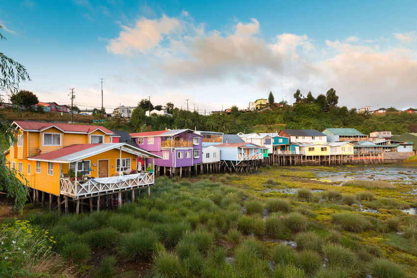 Traditional stilts houses known as palafitos in Castro, Chiloe island, Chile Architecture Chile Chilean  Chilöe Chiloé, Chile Elevated Latin America Palafitos Stilts Castro Chiloe Island House Island Landmark Picturesque Pile Dwelling Pile-dwelling Pillars Stilts House Traditional Village