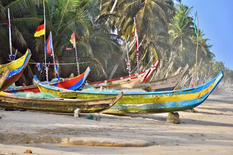Boats moored on beach