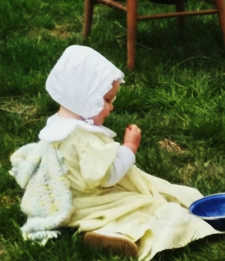 Spring Is In The Air Baby Girl Green Grass 🌱 Baby Dress 1850's Homestead Taking Photos EyeEm Gallery Eyeem Photography Enjoying Life Things I Like Baby Bonnet baby eating 1850's Reinactment Telling Stories Differently 1850s Collection Phoneography The Irwin Collection