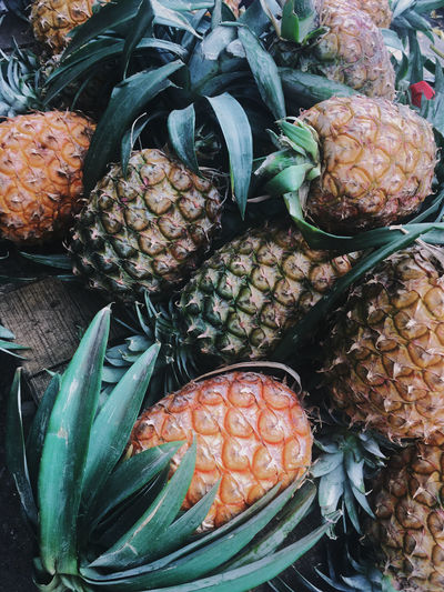 Close-up of honey-sweet pineapple for sale at market stall