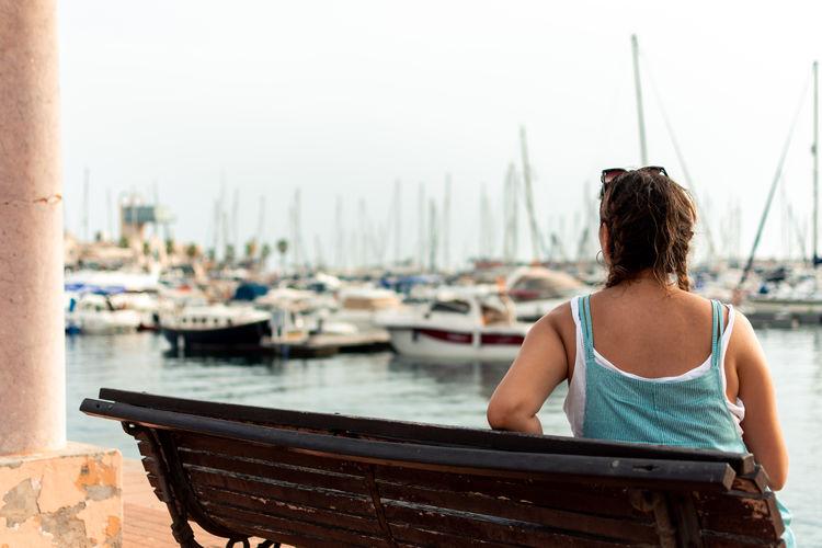 Rear view of woman looking at harbor