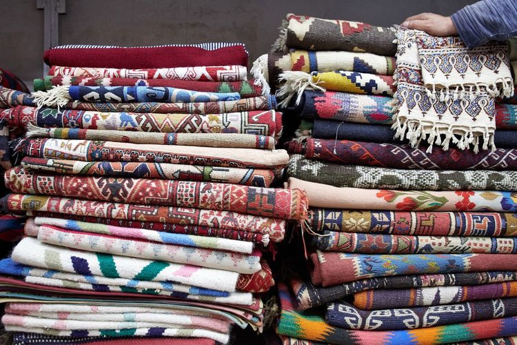 Close-up of folded blankets for sale in store