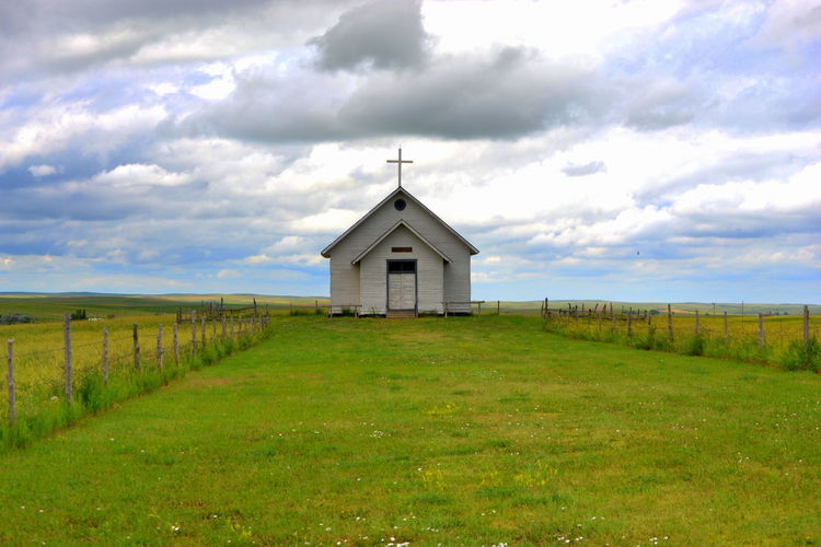 1880 Town Architecture Beauty In Nature Built Structure Church Cloud Cloud - Sky Cloudy Cross Day Field Grass Grassy Green Color Landscape Nature No People Outdoors Religion Rural Scene Scenics Sky Spirituality Tranquil Scene Tranquility