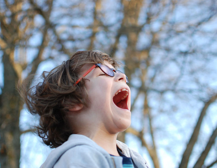 Headshot Tree One Person Curly Hair Bare Tree Outdoors Mouth Open Human Mouth People Front View Close-up Human Body Part Childhood Day Sky Scream Kid Child Boy Glasses Long Goodbye Live For The Story