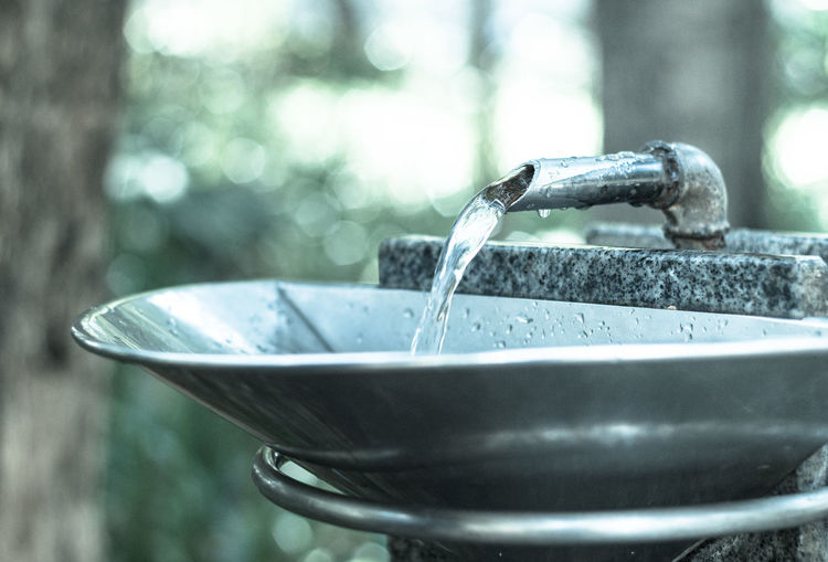 Water flowing from faucet at outdoors