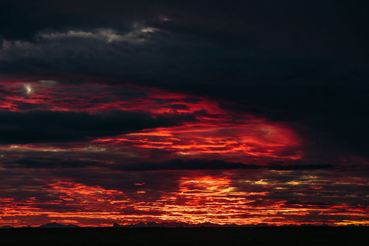Sky on fire Cloud - Sky Dramatic Sky Majestic Nature Night Orange Color Red Scenics Silhouette Sky Sunset