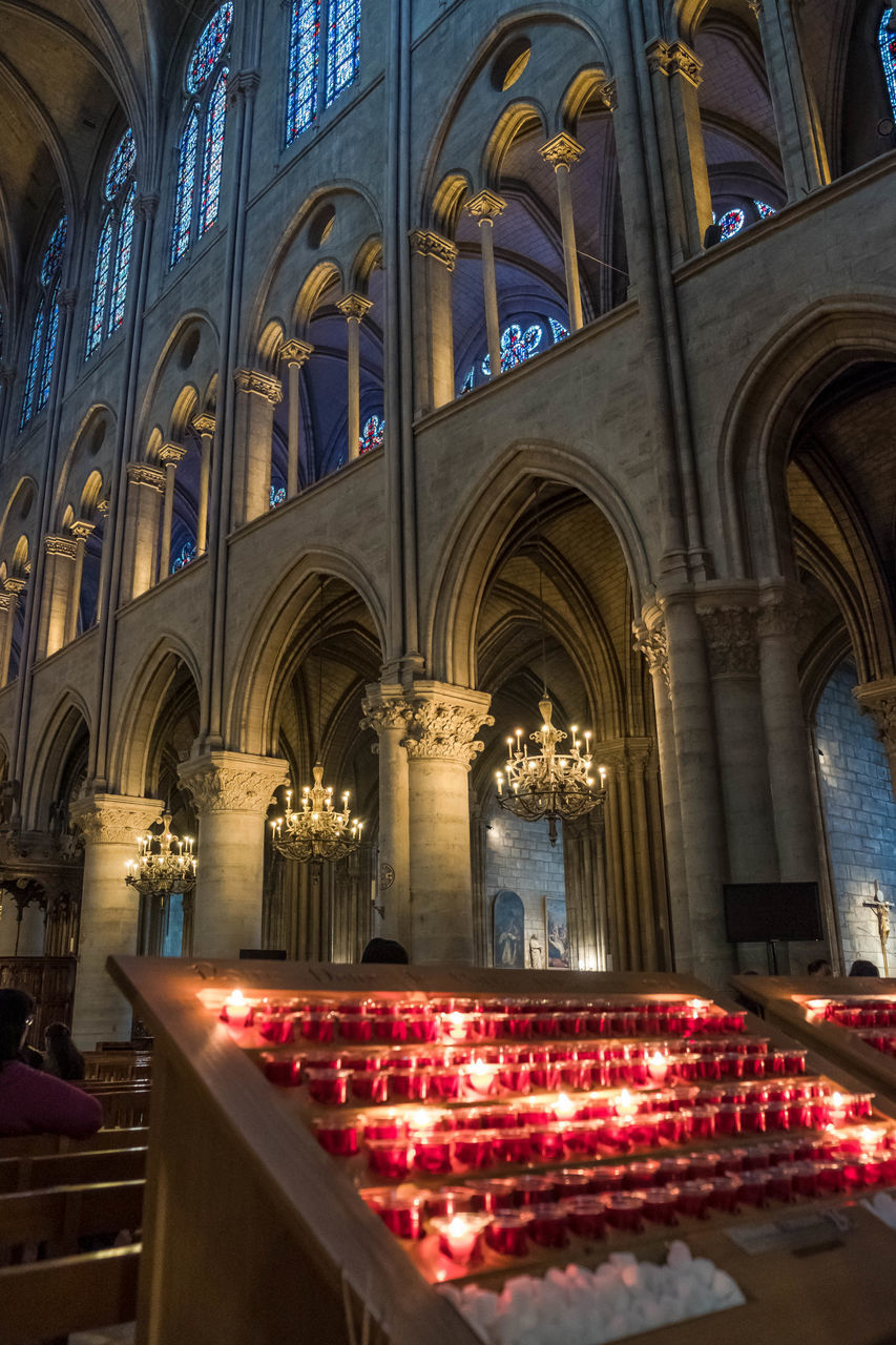 Inside Notre-Dame Architecture Belief Place Of Worship Religion Built Structure Spirituality Notre Dame De Paris Cathedral Inside Light And Shadow Church Gothic Candle Candellight Illuminated No People Lighting Equipment