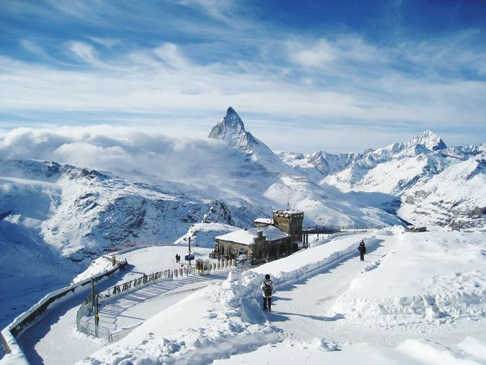 Snow covered gornergrat railway station and mountain against sky