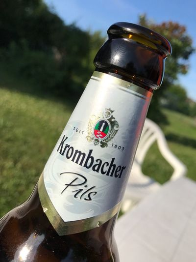 Text Focus On Foreground Close-up Communication Day No People Bottle Outdoors Sky Krombacher Beer Beer Time Beers Mark Brand Logo Logo Design IPhoneography Smartphonephotography Alcohol Drink Relaxing Eye4photography  EyeEm Best Shots