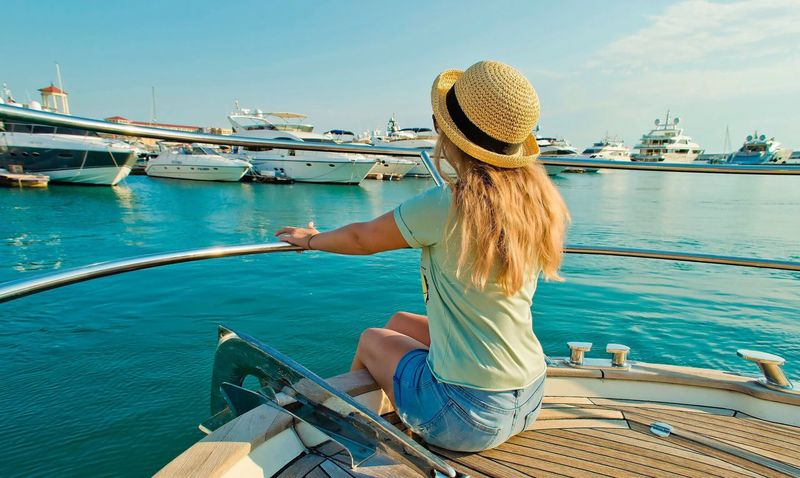 Nautical Vessel Water Sea Transportation One Person Hi! Girls Rear View Sitting Lifestyles Real People Leisure Activity Casual Clothing Women Day Sky Outdoors Sailing Nature Yacht Blond Hair