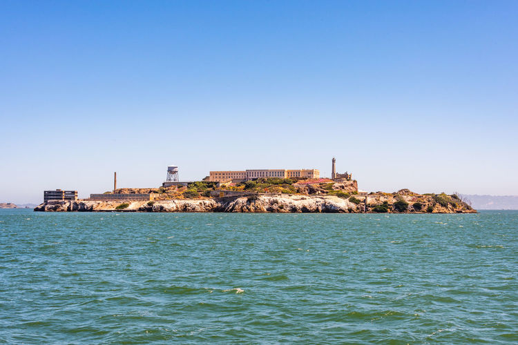 Alcatraz Water Sea Built Structure Architecture Sky Clear Sky Building Exterior Waterfront Copy Space Building Scenics - Nature Beauty In Nature Nature No People Blue Day Land City Beach Outdoors